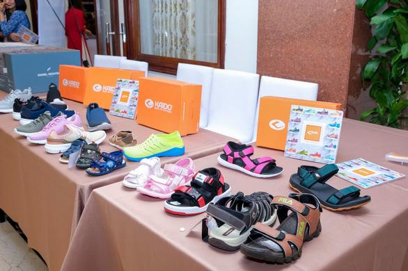 Đẩy mạnh liên kết doanh nghiệp dệt may da giày tận dụng hiệu quả các FTA - Ảnh 2.