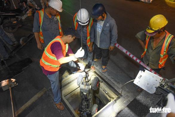 Cận cảnh robot khảo sát cống ngầm ở TP.HCM - Ảnh 6.