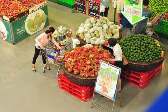 MM hỗ trợ nông dân tiêu thụ thanh long và dưa hấu - Ảnh 1.