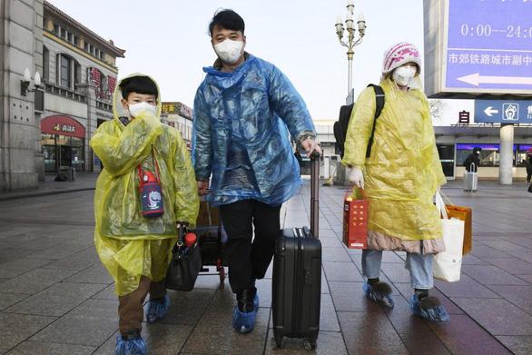 Ủy ban Y tế quốc gia Trung Quốc: 83% ổ dịch Covid-19 tập trung ở hộ gia đình - Ảnh 1.