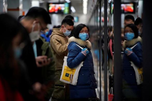 Số ca nhiễm corona mới ở Trung Quốc giảm, dịch bệnh sẽ kết thúc tháng 4? - Ảnh 1.