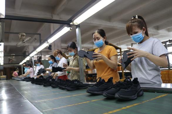 Đòn bẩy cho kinh tế Việt Nam - Ảnh 1.