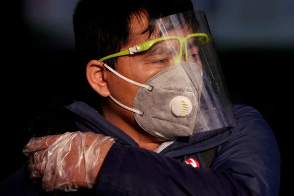 Cập nhật dịch corona ngày 14-2: Hồ Bắc thêm 116 người chết, gần 5.000 ca nhiễm mới - Ảnh 2.