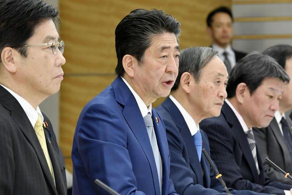 Nhật Bản đẩy mạnh chống virus corona sau cái chết của cụ bà 80 tuổi - Ảnh 1.