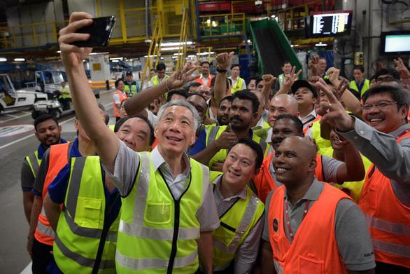 Thủ tướng Singapore thừa nhận khả năng suy thoái kinh tế, khó giải quyết nhanh COVID-19 - Ảnh 1.