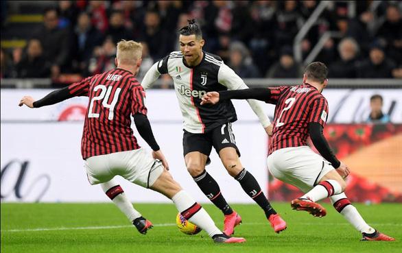 Ronaldo ghi bàn phút 90+1 giúp Juventus cầm hòa AC Milan - Ảnh 1.