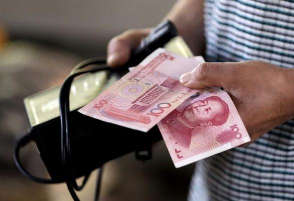 Trung Quốc khử trùng tiền mặt, in tiền mới cho Vũ Hán giữa dịch COVID-19 - Ảnh 1.