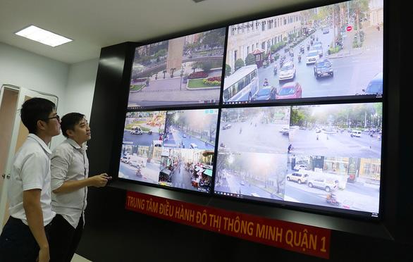 Thí điểm xây dựng đô thị thông minh:  Nhiều ứng dụng thiết thực phục vụ người dân - Ảnh 1.
