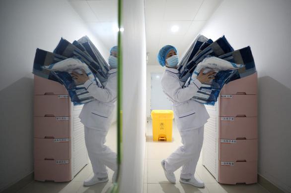WHO điều tra dịch bệnh do virus corona ở Trung Quốc - Ảnh 1.