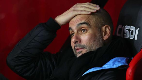 Man City bị cấm dự Champions League 2 mùa tới, nộp phạt 30 triệu euro - Ảnh 1.