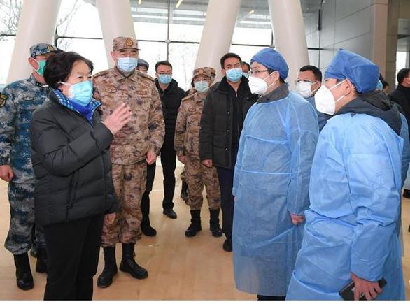 Hơn 9.400 người xuất viện ở Trung Quốc, số ca nhiễm mới giảm ngày thứ 3 liên tiếp - Ảnh 1.