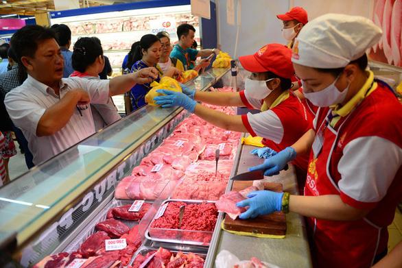 Giá thịt heo giảm, kéo lạm phát tháng 11 giảm 0,01% - Ảnh 1.