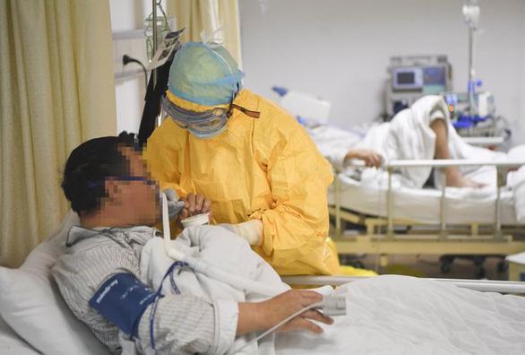 Chuyên gia Việt Nam nói gì về thuốc chống COVID-19 của Trung Quốc? - Ảnh 1.