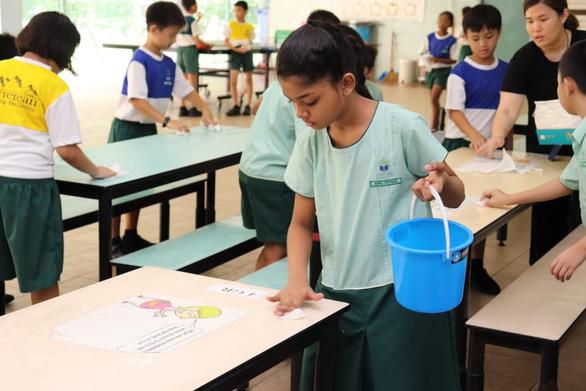 Con tôi ở Singapore vẫn đi học - Ảnh 1.