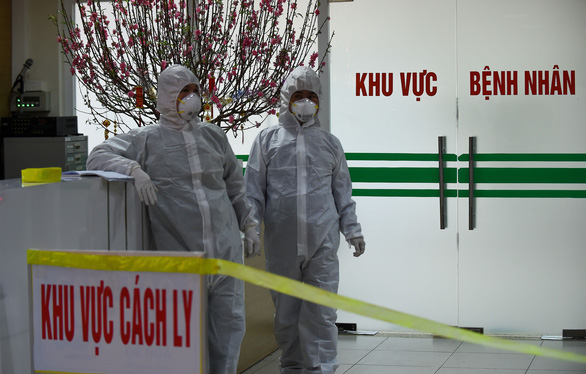 Một Việt kiều ở TP.HCM dương tính virus corona sau khi quá cảnh Vũ Hán - Ảnh 1.