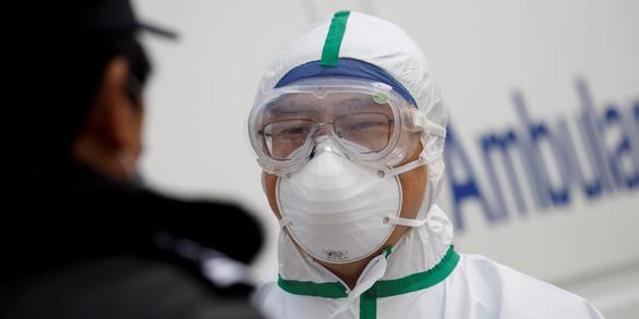 Trung Quốc cấm tổ chức tang lễ cho nạn nhân virus corona - Ảnh 1.