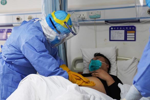 Hàng trăm người được chữa khỏi virus corona, cho xuất viện ở Trung Quốc - Ảnh 2.