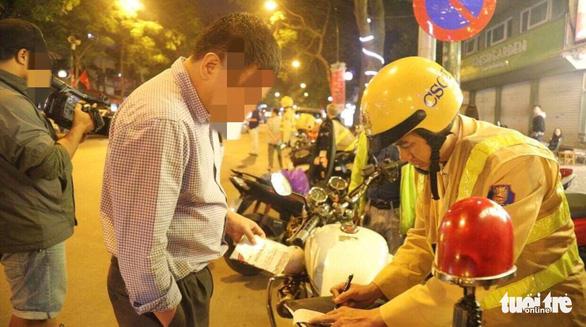 Người vi phạm giao thông được nộp tiền phạt qua Cổng dịch vụ công quốc gia - Ảnh 1.