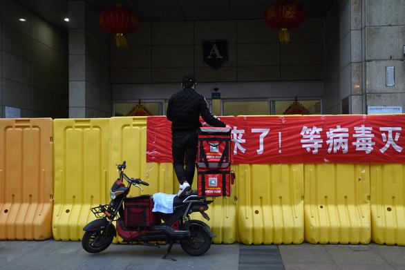 Trung Quốc: Ngành kinh doanh, sản xuất mở lại gần như bình thường - Ảnh 2.