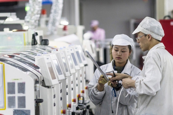 Foxconn thưởng 1.000 USD cho công nhân quay lại làm việc - Ảnh 1.