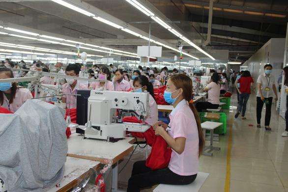 Bình Phước tạm ngưng tiếp nhận lao động Trung Quốc trở lại làm việc - Ảnh 1.