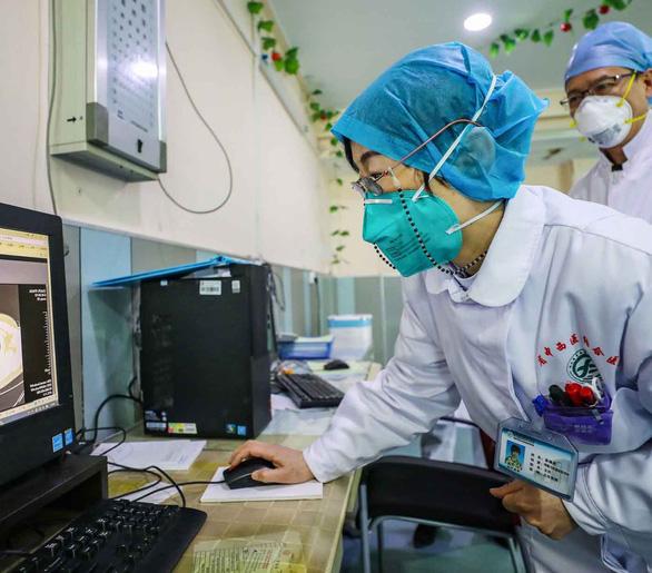 WHO thận trọng trước thông tin thuốc điều trị virus corona - Ảnh 1.