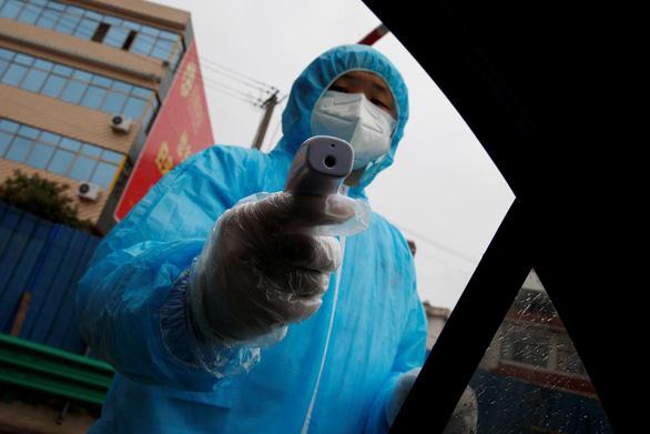 Thành phố Đại Lý chặn xe lấy khẩu trang của hàng xóm Trùng Khánh - Ảnh 1.