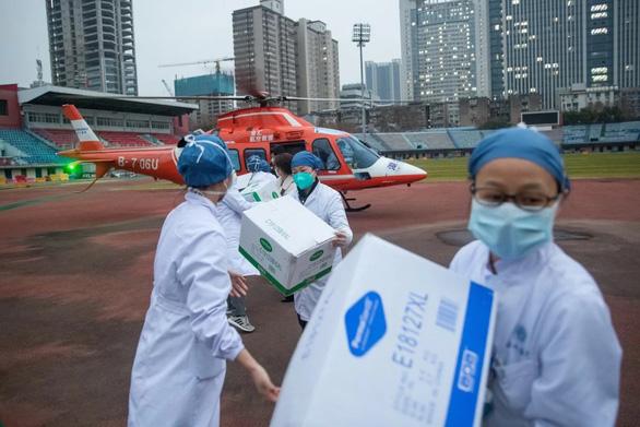 Trung Quốc nhờ hỗ trợ những gì để đối phó đại dịch virus corona? - Ảnh 1.