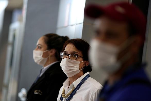 Tổ chức Y tế thế giới: Người khỏe mạnh không cần đeo khẩu trang - Ảnh 1.