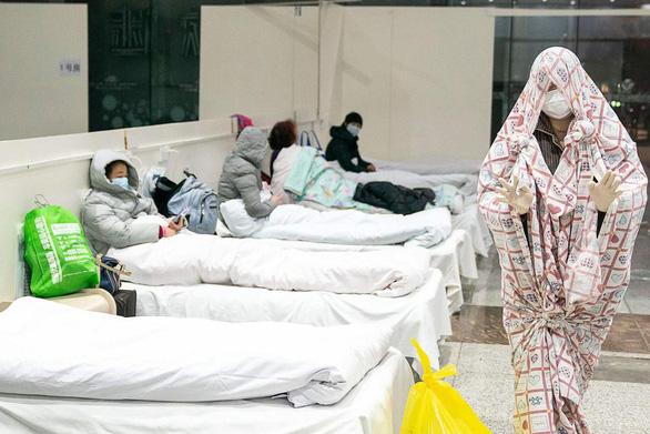Bác sĩ tuyến đầu trị corona ở Trung Quốc: Hầu hết người nhiễm sẽ khỏi sau 2 tuần - Ảnh 1.