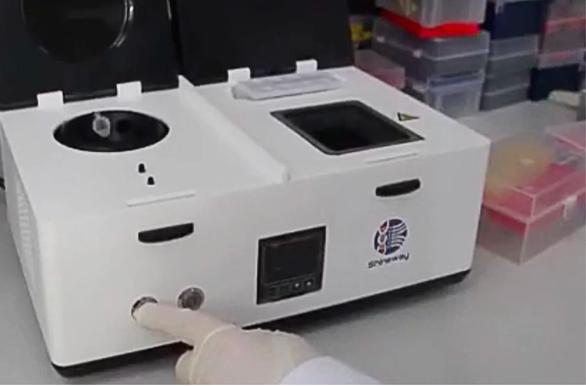 Hong Kong phát minh thiết bị phát hiện virus corona trong 40 phút - Ảnh 1.