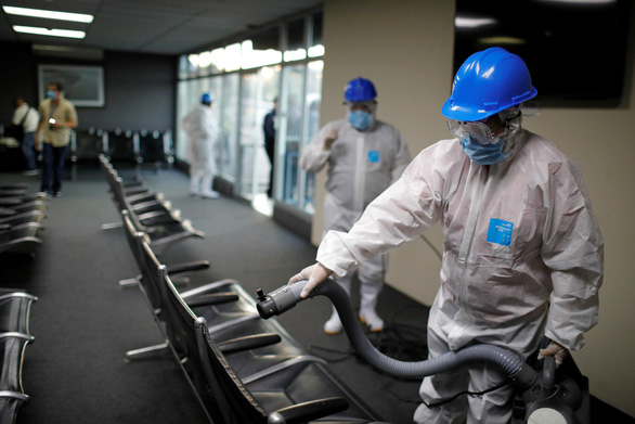 Nhân viên dính COVID-19, WTO lo phòng dịch - Ảnh 1.
