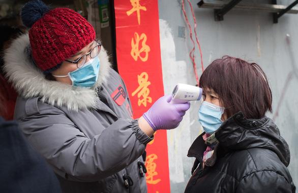 Nhân viên Bắc Kinh kẹt tại Hồ Bắc được trợ cấp hơn 400 USD/tháng - Ảnh 1.