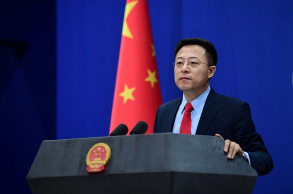 Trung Quốc nghi quân đội Mỹ đưa virus corona vào Vũ Hán - Ảnh 1.