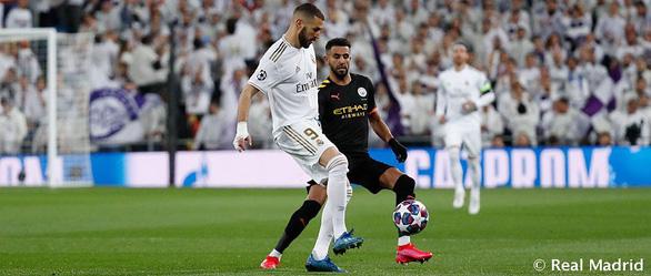 Cầu thủ Real Madrid bị cách ly, hoãn trận lượt về Champions League với Man City - Ảnh 1.