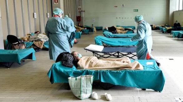 Dịch COVID-19 ngày 14-3: Số tử vong ở Ý tăng kỷ lục, ca nhiễm ở Mỹ lên gần 2.500 - Ảnh 4.