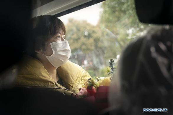 Nhiều tỉnh ở Trung Quốc khôi phục giao thông, cuộc sống dần bình thường - Ảnh 2.