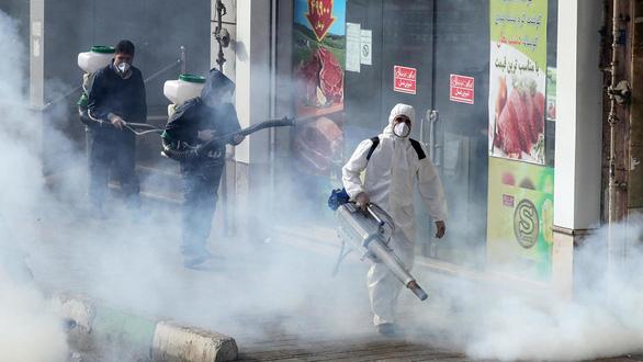 Virus corona giúp giảm nhiệt xung đột Mỹ - Iran? - Ảnh 1.