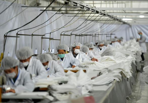 Sản lượng công nghiệp Trung Quốc giảm mạnh nhất trong 30 năm - Ảnh 1.
