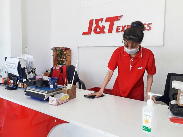 J&T Express gắn Thẻ Bưu kiện an tâm trên từng bưu phẩm - Ảnh 5.