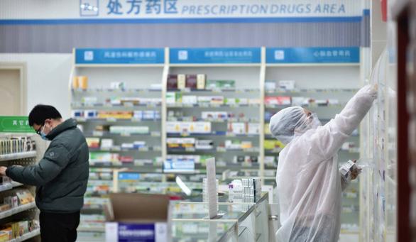 Trung Quốc dùng thuốc chữa cúm đang được Nhật thử nghiệm để chữa virus corona - Ảnh 1.