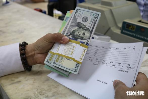 Đôla Mỹ tăng, đôla Úc xuống kỷ lục ngày 18-3 - Ảnh 1.