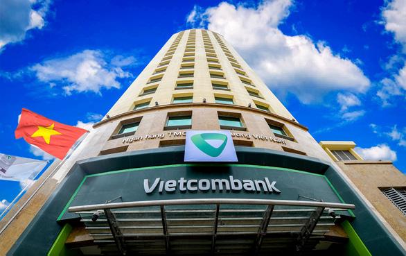 Vietcombank tiếp tục cơ cấu lại nợ và giữ nguyên nhóm nợ cho các khoản vay bị thiệt hại do COVID-19 - Ảnh 1.