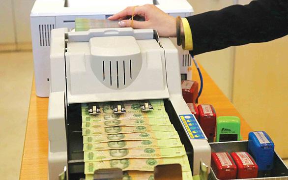 Doanh nghiệp ngóng giảm lãi suất khoản vay cũ, ngân hàng nói sẽ tiếp tục theo dõi - Ảnh 1.