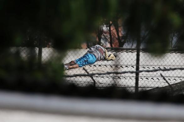 Bạo loạn trong tù vì dịch bệnh COVID-19 ở Colombia, 23 người chết - Ảnh 2.