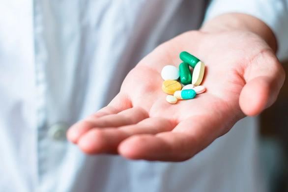 4 loại thuốc chống COVID-19 tiềm năng đang thử nghiệm toàn cầu - Ảnh 1.