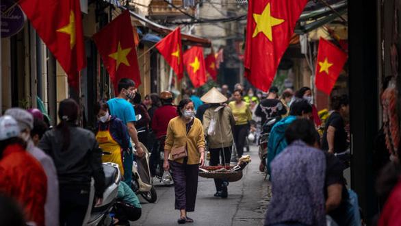 Financial Times đánh giá cao mô hình chống COVID-19 chi phí thấp ở Việt Nam - Ảnh 1.