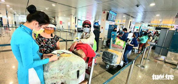 Hàng không Việt Nam chính thức tạm ngưng bay quốc tế - Ảnh 1.