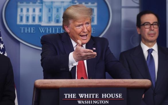 Điều gì sẽ xảy ra nếu nước Mỹ sớm mở cửa trở lại theo lời ông Trump? - Ảnh 1.