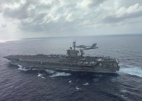 Thủy thủ tàu sân bay ghé Đà Nẵng có thể mắc bệnh COVID-19 từ một nguồn khác - Ảnh 1.